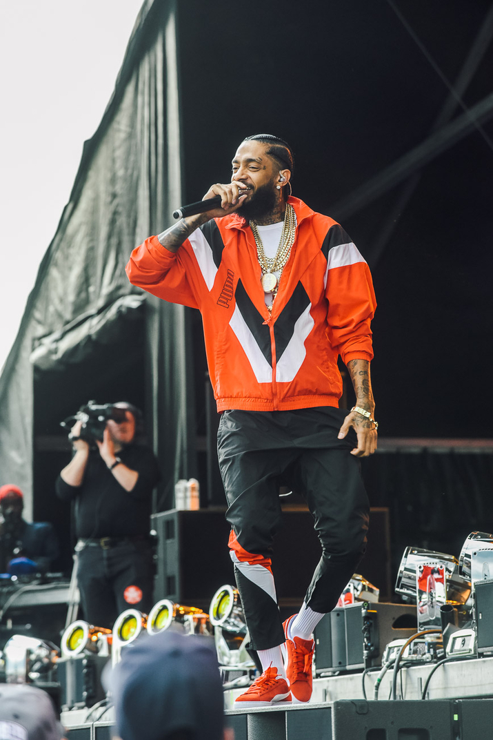 Image result for nipsey hussle on stage